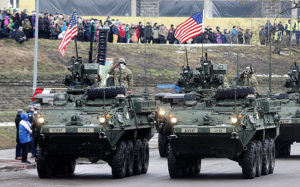 US soldiers attend military parade celebrating Estonia's Independence Day near border crossing with Russia in Narva (REUTERS)